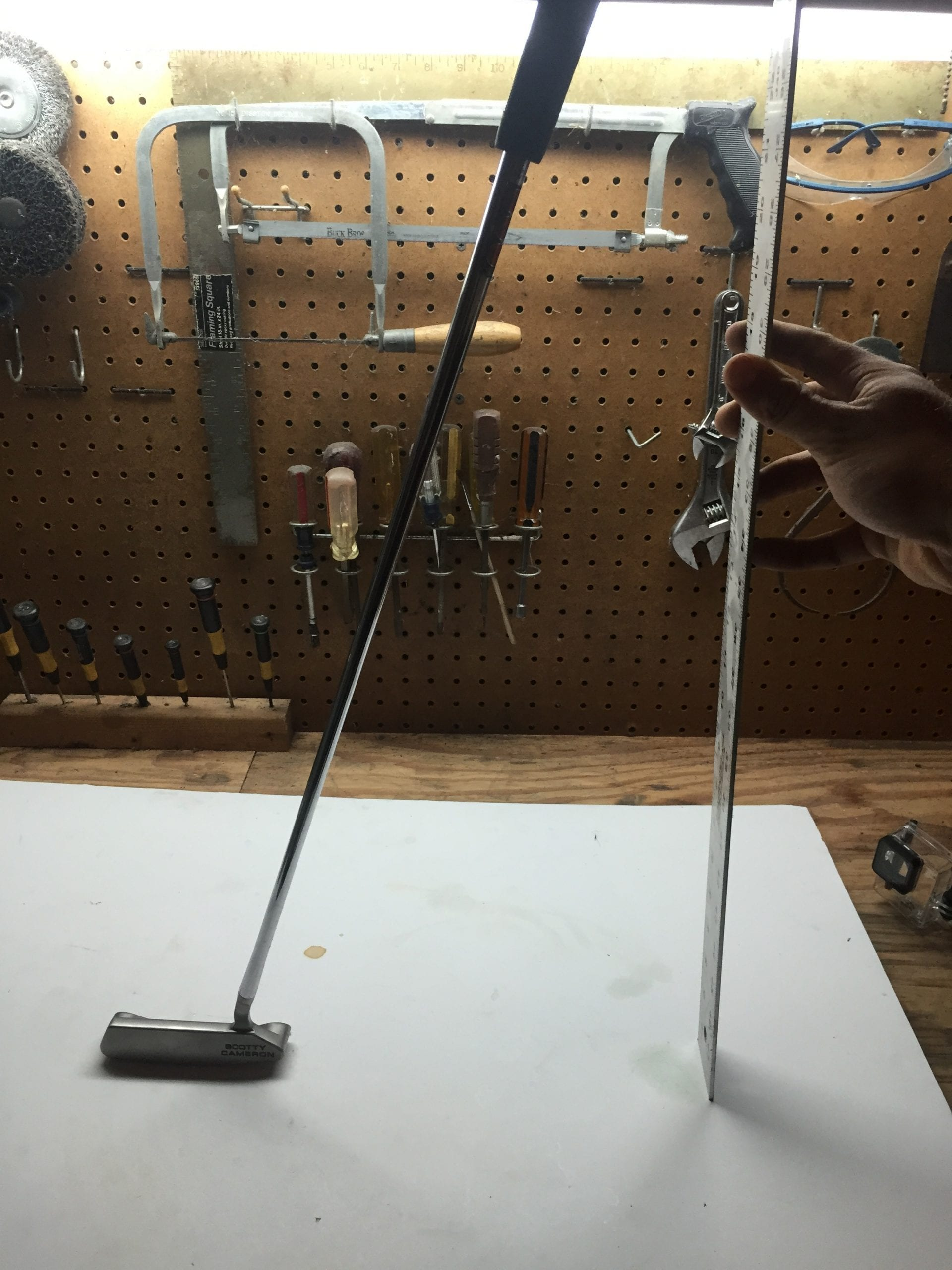 measuring the length of a putter