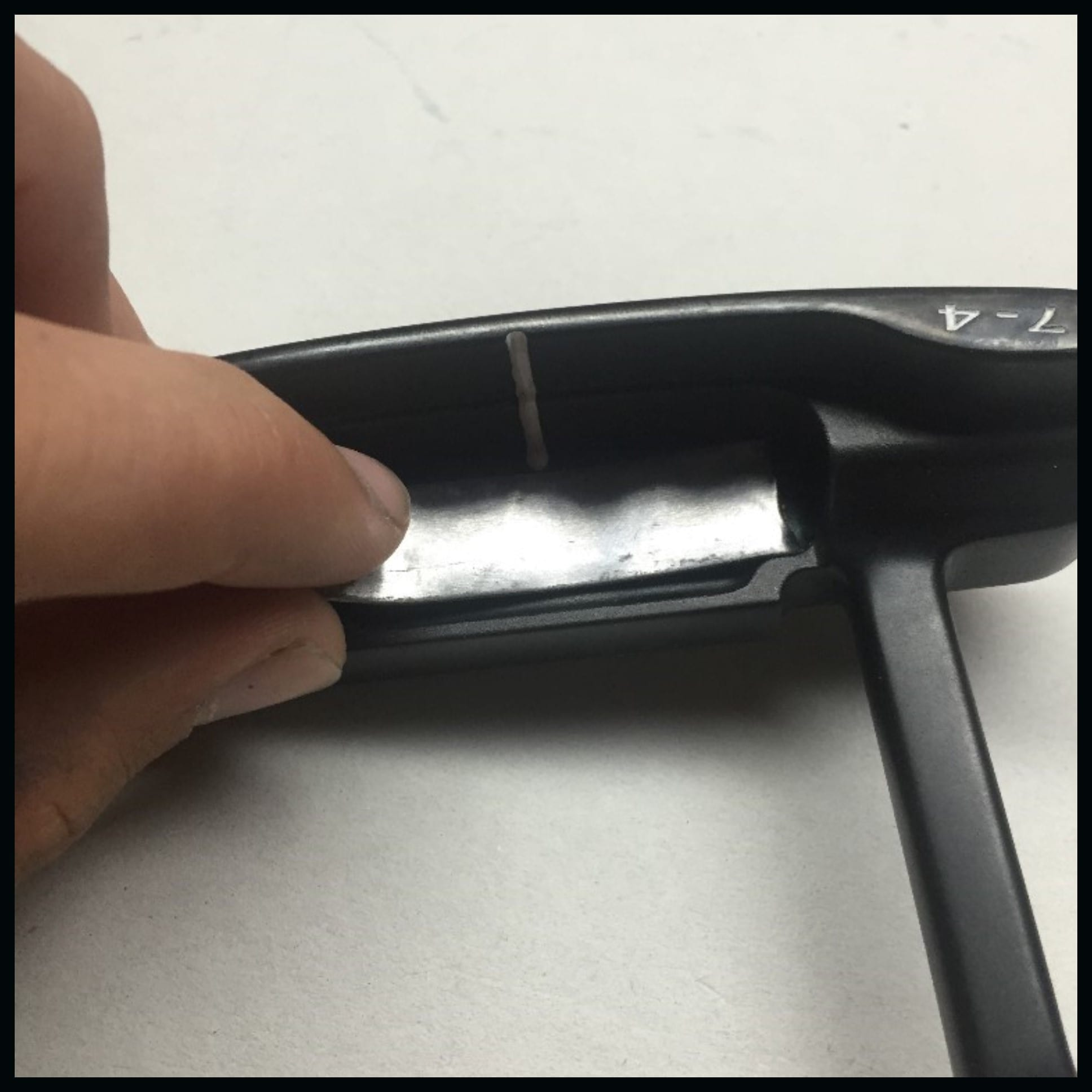 applying lead tape to putter